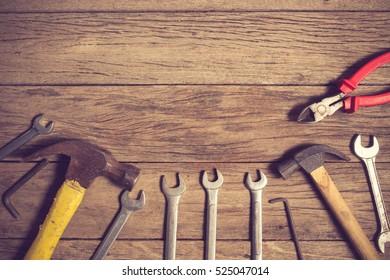 old tools on wooden background.Vintage color