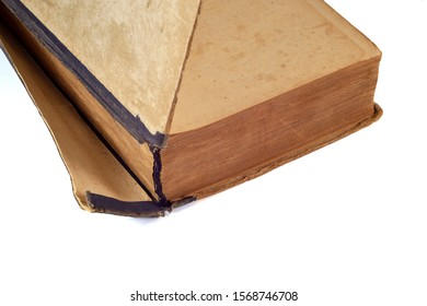 Old torn book requiring repair on a white background
