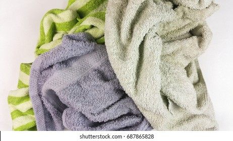 old towels on white background - top view