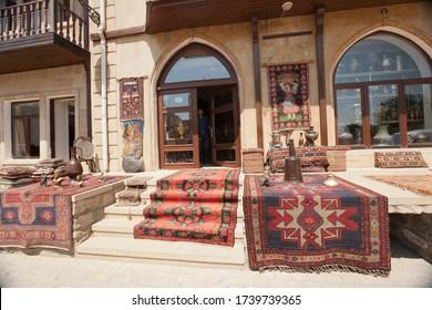 Old town, Azerbaijan, craft market on the street, sunny day, no body, carpets, tradition souvenirs, asia style. 10 July 2014, Azerbaijan, Baku.