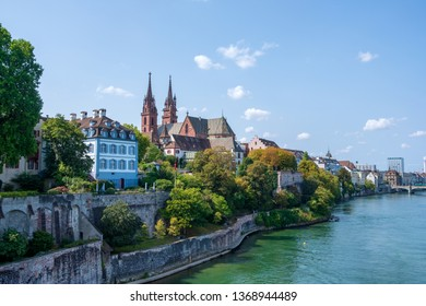 The Old Town of Basel with red stone Munster cathedral and the Rhine river, Switzerland