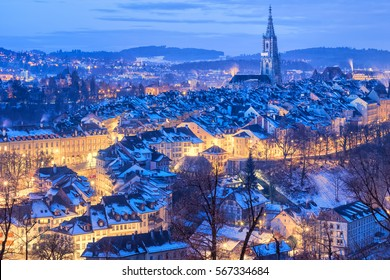 Old Town of Bern, capital of Switzerland, covered with white snow in the evening blue hour
