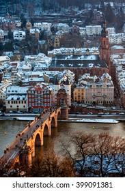 Old town and old bridge in snow in Heidelberg, Germany