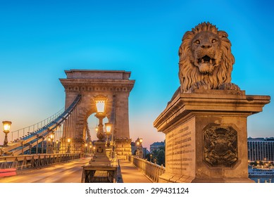 Old Town of Budapest, Hungary. Famous spectacular The Szechenyi Chain Bridge in the astonishing colorful sunrise of summer. One of most representative landmarks of beautiful Hungarian capital city.