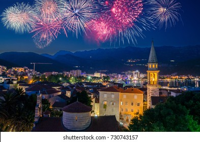 Old town of Budva at night with fireworks on the black sky, Montenegro