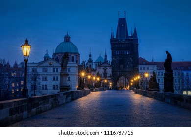 The Old Town with Charles bridge in Prague early in the morning with light of city lamps