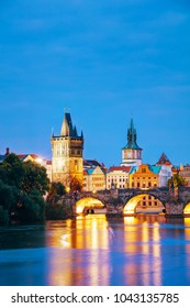 The Old Town Charles bridge tower in Prague in the evening