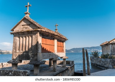 The old town of Combarro has the largest collection of horreos (typical granaries) and Cruceiros (traditional Calvary sculptures) in Galicia, the town is near Sanxenxo, Pontevedra, Spain.