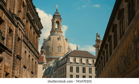 Old town of Dresden - baroque buildings red roofs of houses on the background of the river Elba create a beautiful landscape of the historic city.