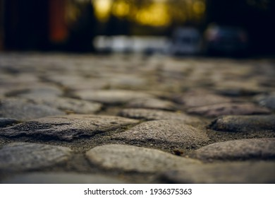 Old town in Europe at sunset with retro vintage cobble stone. cobble paving Stones background for walking.