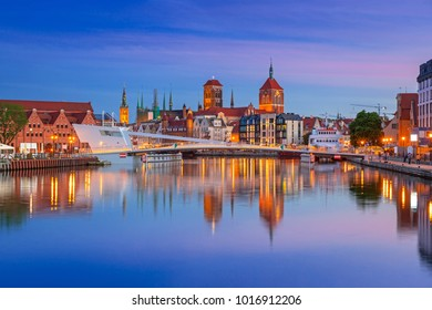 Old town in Gdansk and catwalk over Motlawa river at sunset, Poland