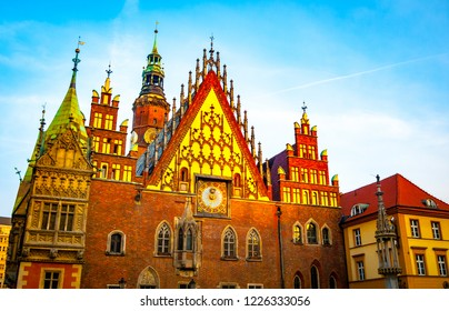 Old Town Hall in Market Square hit by the first rays of the rising sun, Wroclaw. Lower Silesia, Poland