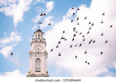 Old Town Hall of Vitebsk in sunny summer day. Clock tower in the city. Vitebsk, Belarus.