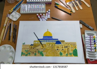 Old town of Jerusalem in arts. Miniature of Golden Dome of the Rock. Islamic art. Hands of the young artist of the miniature painter. Baku - Azerbaijan 19 January 2019