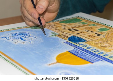 Old town of Jerusalem in miniature. Miniature of Golden Dome of the Rock. Masjid al-Aqsa. Islamic art. Hands of the young artist of the miniature painter.