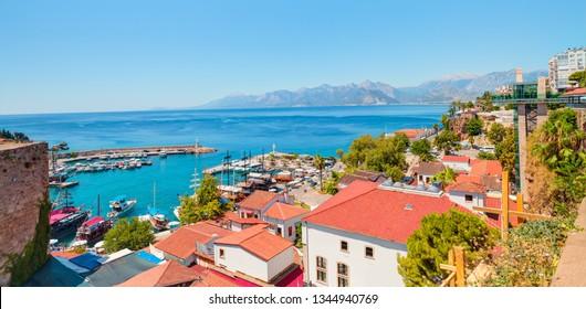 Old town (Kaleici) in the background Konyaalti beach and mountains -  Antalya, Turkey