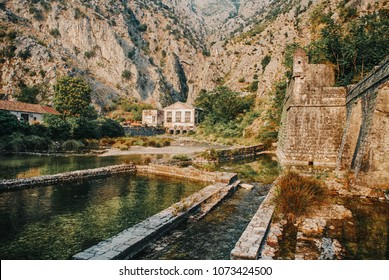 Old town Kotor with Fortifications on mountains background