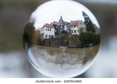Old town with lake, glass ball