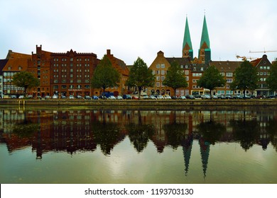 Old town Lubeck, Germany. Embankment of the river Trave. Vintage photography.