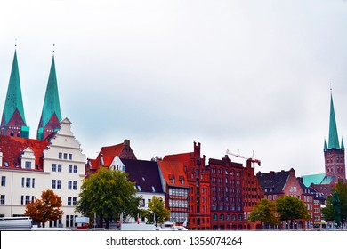Old town Lubeck isolated on a white background. Embankment of the river Trave, Germany.