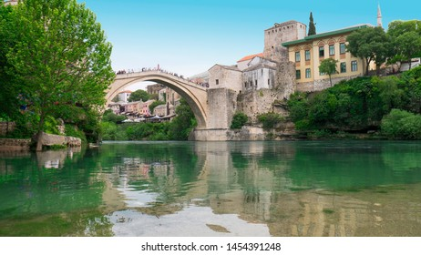 Old town of Mostar and Stari Most bridge above beautiful emerald river Neretva. - April 2019, Mostar, Bosnia and Herzegovina.