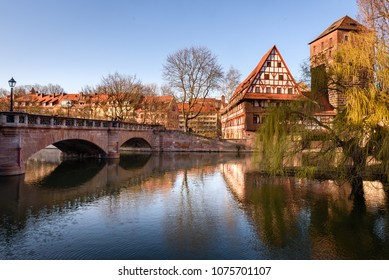 Old town of Nuremberg, Germany. Bridge over river Pegnitz with traditional half-timbered house and tower on riverside in old town Nuremberg, Bavaria, Germany.