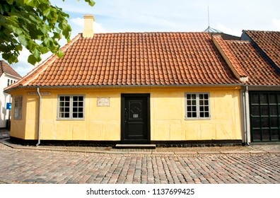 Old town of Odense, Denmark. HC Andersen's hometown. Yellow house is the birthplace of Hans Christian Andersen. JUNE 17, 2018 - Odense, Denmark
