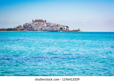 Old town on the sea. The castle of Peniscola, located on Costa del Azahar in the Castellon province of Spain. This popular tourist destination is located on a rocky headland.