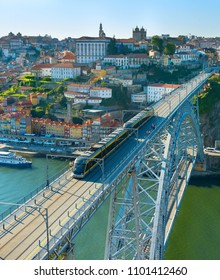 Old Town of Porto, Douro river and tram on Dom Luis bridge. Portugal