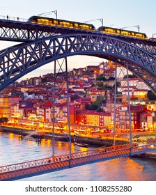 An Old Town of Porto seen through the Dom Luis bridge at twilight. Portugal