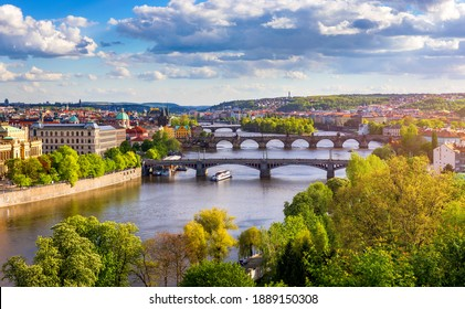 Old town of Prague. Czech Republic over river Vltava with Charles Bridge on skyline. Prague panorama landscape view with red roofs.  Prague view from Letna Park, Prague, Czechia.