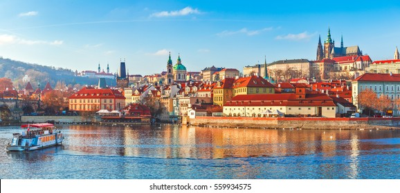 Old town of Prague. Czech Republic over river Vltava with Saint Vitus cathedral on skyline. Bright sunny day blue sky. Praha panorama landscape view.