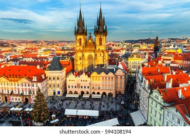 Old Town of Prague, Czech Republic. View on Tyn Church and Jan Hus Memorial on the square as seen from Old Town City Hall. Blue sunny sky