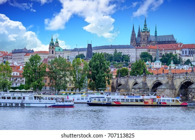 Old town of Prague. Czech Republic over river Vltava with Saint Vitus cathedral on skyline. Bright sunny day blue sky.