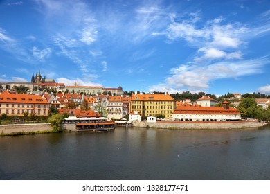 Old town of Prague over river Vltava with Saint Vitus cathedral on skyline.