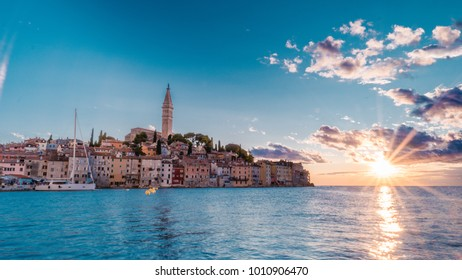 Old town of Rovinj Croatia during sunset with colorful sky at the ocean of the adriatic sea, Istria Rovinj Croatia evening scenery