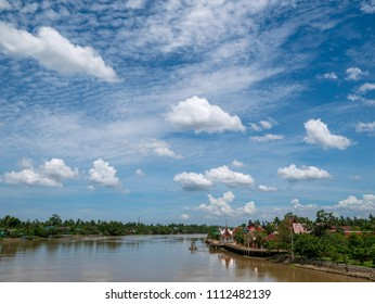 The Old Town of Samut Songkhram on the Riverbank with clouds in blue sky