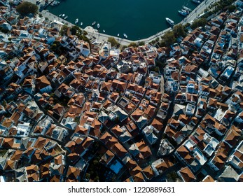 Old Town of Skopelos and harbor from above, island of Skopelos, Rooftops Vertical Drone Photo of Old Houses