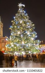 Old Town Square with Christmas market, tree and Church of our Lady Tyn in the city of Prague, Czech Republic