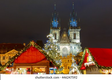 Old Town Square with Christmas market, tree and fairy tale Church of our Lady Tyn in the magical city of Prague at night, Czech Republic