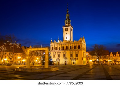 Old town square with historical town hall in Chelmno at night, Poland