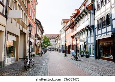 Old town street in Goettingen, Lower Saxony, Germany. Numerous shops. Cobblestone street.