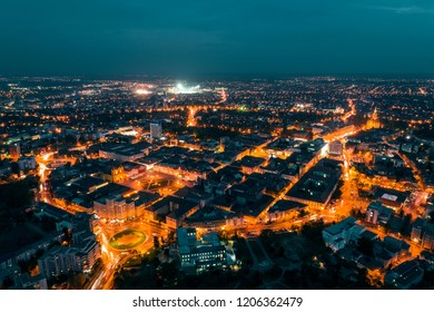 Old town Timisoara with beautiful city lights at blue hour - aerial view taken by drone