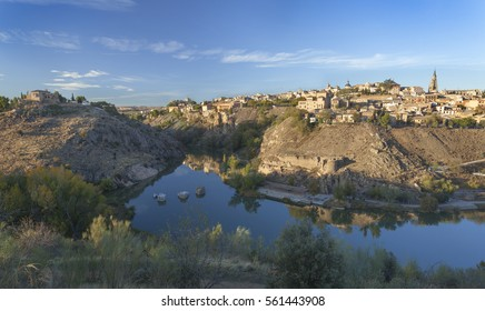 Old town Toledo and its reflection in river Tajo, Spain