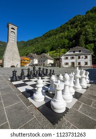 The old town of Zelezniki town square with the chess and the  big old iron furnace