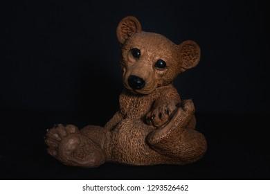 old toy bear -dark background