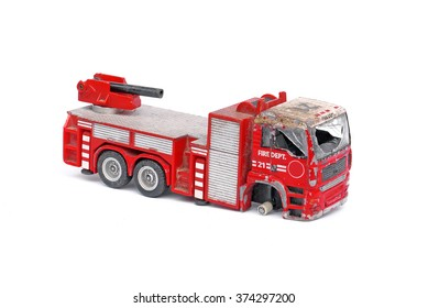 old toy fire engine broken and damaged