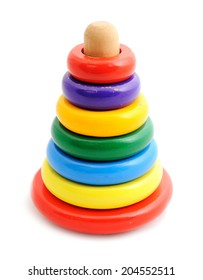 Old toy pyramid with colored rings for baby active learning