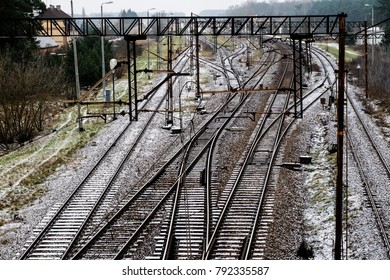Old track at the railway station. Winter scenery of railway tracks with a passing train. Winter scenery.