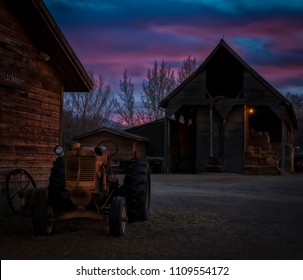 Old tracter with a sunset of beauty behind in Utah.
